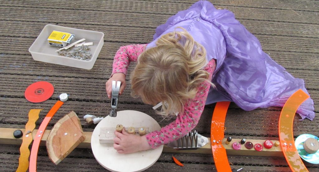 Child using woodworking tools